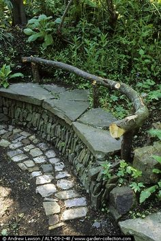 Rustic stone and wood bench in shade