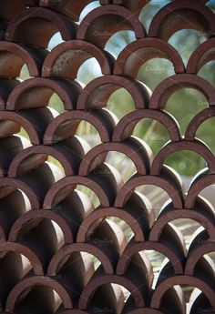 Half Circle Stacked 2 Photos Clay or Adobe half circle roof tiles stacked like a. Half Circle Stacked 2 Photos Clay or Adobe half circle roof tiles stacked like a wall. Bamboo Roof, Bamboo Art, Bamboo Crafts, Bamboo Fence, Clay Roof Tiles, Bamboo House Design, Brick Projects, Bamboo Building, Bamboo Structure