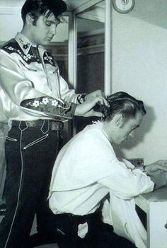Elvis cutting a young man's hair 1950's
