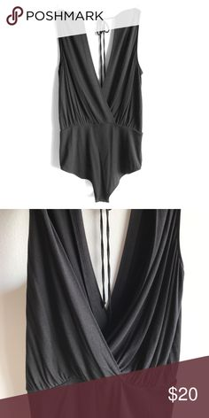 BCBG - body suit this is a slouchy unitard perfect for that tucked in look with jeans. MAKE AN OFFER ! BCBGeneration Tops