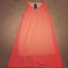 Peach colored dress Peach colored dress. White underneath. Never worn. NWT. Dresses Midi