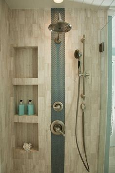 An accent stripe of glass tiles adds interest to this neutral shower. Sleek niches provide storage for shower essentials, and dual shower heads create a luxurious atmosphere ~ http://walkinshowers.org/best-shower-niches.html