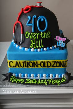 Old Zone This two tier cake is uniquely shaped & iced in fondant. Decorations include a gum paste stethoscope, caution tape and over the hill candle. 40th Cake, 40th Birthday Cakes, 40th Birthday Parties, 40 Birthday, Over The Hill Cakes, Two Tier Cake, Raspberry Mousse, Buttercream Filling, Funny Cake