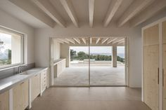 Nomo Studio designed Stone House as a symbiosis between the natural coastal landscape of Menorca, Spain, and contemporary architecture. Limestone House, Limestone Wall, Wooden Shutters, Ceiling Beams, Concrete Floors, Contemporary Architecture, Architecture Design, White Walls, Second Floor