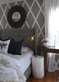 Love the criss-cross accent wall but wouldve been cuter if it contrasted the headboard