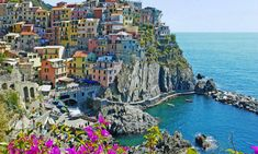 Manarola – a small fishing village in Liguria, northern Italy. The city is located on a cliff overhanging the wild coastline of the Ligurian Sea.