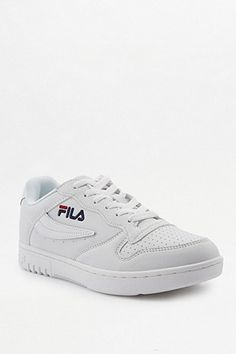 cbb2d09cafd7ec Shop FILA White Low Top Trainers at Urban Outfitters today.