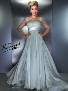 Perfect mother of the bride evening gown.  Pleated gown with empire waist and illusion sleeves decorated with rhinestones. Satin waistband defines your shape.