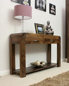 This gorgeous, contemporary walnut console table with two drawers is truly a thing of understated beauty. The piece is carefully crafted from the highest grade solid walnut hardwood sourced from managed, sustainable plantations. Only £359.