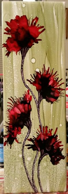 Flowers in alcohol ink on 12x4 tile by Tina working on decreasing my need for symmetry. No easy task.  :-)