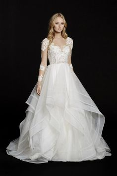 Style 6556 Elysia / Ivory long sleeve lace bridal ball gown, V-front bateau illusion neckline, keyhole back with piping accent, cascading tulle skirt with thin double horsehair edging.