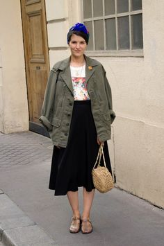 Lady Moriarty. cargo jacket on graphic tee and black midi skirt.
