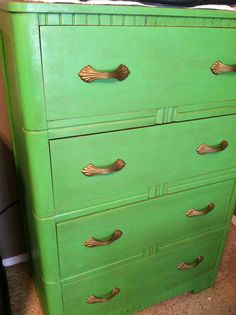 Lovely chalk painted dresser redo.  This is a garage sale treasure.  Painted with ASCP in Antibes Green!