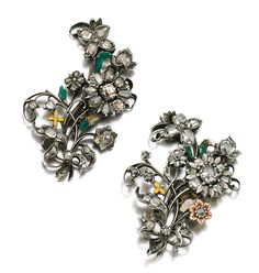 PAIR OF ENAMEL AND DIAMOND BROOCHES, LATE 18TH CENTURY.  Each designed as a spray of flowers set with table-cut and rose diamonds, highlighted with translucent and opaque brightly coloured enamel, each with detachable later brooch fittings.