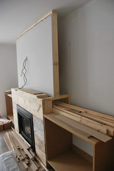 Want to build DIY fireplace built ins? See the play-by-play of how our craftsman style built ins were created using MDF, white paint, stone & marble tile. Build A Fireplace, Fireplace Built Ins, Home Fireplace, Faux Fireplace, Living Room With Fireplace, Fireplace Design, Living Room Decor, Fireplace Ideas, Fireplace Seating