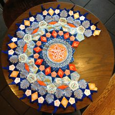 Blue and Orange Passacaglia Rosette, plus Fussy Cutting Tips by East Dakota Quilter