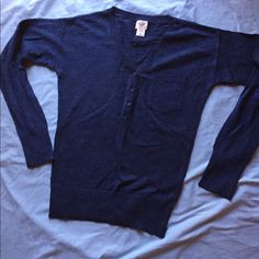 Mossimo blue sweater like new This is a sweater that I think I wore once. It is by Mossimo. Comfortable and soft material 100% cotton. Buttons in the front and a pocket. A nice blue. V neck Mossimo Supply Co Sweaters