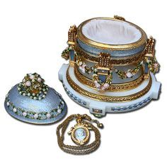 The Imperial Cradle Egg with Garlands FabergeGifts.com - Faberge Imperial Eggs, the perfect gift.