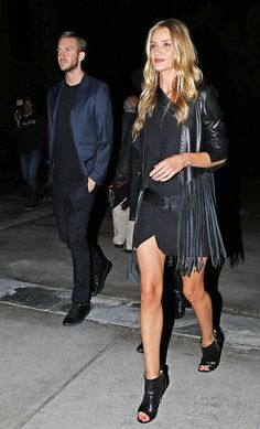 How to Wear All Black Like Rosie Huntington-Whiteley This Fall via @WhoWhatWear -plain outfit?...just add fringe