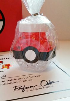 Simple and fun party favor for a Pokémon inspired party! Orbeez water beads are used to fill a container to give this favor it's pokeball appearance. Photo and blog at eversosweetparty.wordpress.com