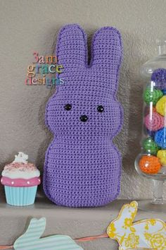 While Easter isn't really about bunnies or baskets — my family celebrates that He is Risen — we also enjoy sharing the fun, whimsical traditions with our son. I couldn't resist crocheting a Peep candy bunny to share with all of you. He (or she) can be any color you'd like — and remain calorie …