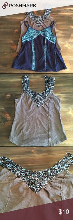 Free People/Bethany Mota Bundle XS This is for (2) tank tops. Both XS. The first one is by Free People and it is gray with pretty blue floral detailing on the chest and multi-straps. This has been used, but there is no rips, holes, or stains. The second tank is by Bethany Mota and it is blue with a turquoise tribal design. In good used condition. Tops Tank Tops