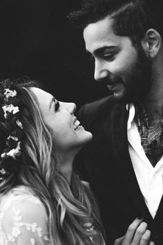 black and white wedding photograph of the happy bride and groom couple
