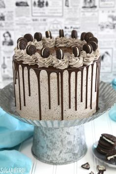 Cookies and Cream Cake - this epic cookies and cream layer cake will satisfy ALL of your chocolate cravings! It has rich devil's food cake plus buttercream with lots of cookie crumbs mixed right in. | From SugarHero.com
