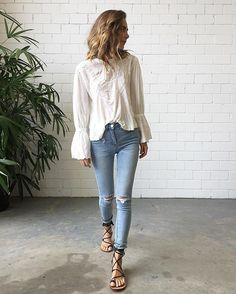 Tuesday's in our #FreePeople Femme Fatale Blouse $239 | #CamillaAndMarc Stevie Jeans ( back in stock tomorrow !!!!) and #Splice Bella Sandals !