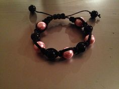 Pink and black shamballa style bracelet