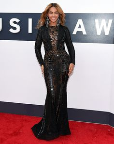 Sheer, Bey! Beyonce ditched her panties while making a quick and speedy appearance as one of the final celebrities to hit the red carpet of the 2014 MTV VMAs. What do you think of her black lace and beaded gown by Nicolas Jebran?