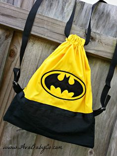 This item is a Batman themed drawstring backpack. The straps are adjustable. There is a zippered pocket on the inside. This measures approx. Batman Baby Clothes, Baby Boy Batman, Batman Clothing, Batman Bag, Im Batman, Superman, Batman Stuff, Backpack Pattern, Backpack Purse