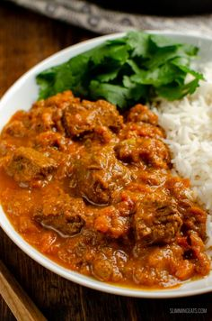 Heavenly Bombay Beef Curry - tender pieces of beef in a delicious aromatic curry sauce and can be cooking stove top or in an Instant Pot. Indian Beef Recipes, Asian Recipes, Healthy Recipes, Ethnic Recipes, Healthy Dinners, Curry Dishes, Beef Dishes, Rice Dishes, Pasta Dishes