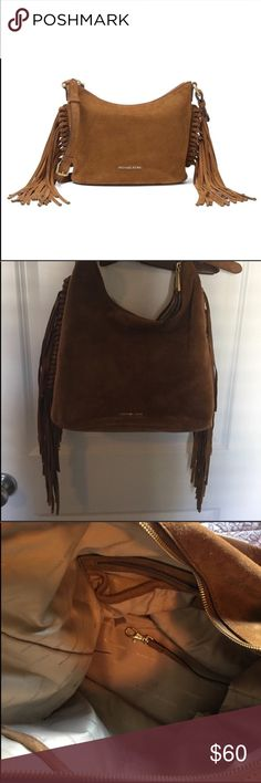 "Michael Kors Brown Fringe Billy Suede Purse Super cute brown fringe suede shoulder bag/purse from Michael Kors ""Billy"". Small dark stain on bottom of bag but otherwise great condition. I'm sure the stain can be washed out but I am too lazy and have too many bags to clean it. A great piece to any wardrobe or style. KORS Michael Kors Bags Shoulder Bags"