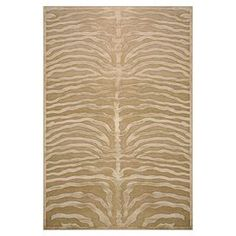 Art silk rug with an ivory zebra-print motif.  Product: RugConstruction Material: Art silkColor: Ivory Note: Please be aware that actual colors may vary from those shown on your screen. Accent rugs may also not show the entire pattern that the corresponding area rugs have.Cleaning and Care: Vacuum on hard floor setting, without beater bar
