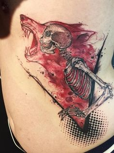Tatuaje de lobo y calavera