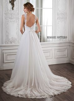 Lace and tulle ballgown wedding dress with V-neckline and Swarovski crystal belt. Complete with cap-sleeves. Crystal by Maggie Sottero.