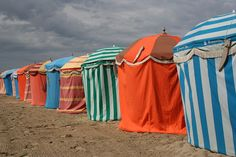Colourful beach parasols at Trouville-sur-mer. This scene has been painted by both Degas and Monet previously !               #France  Surefire way to Learn French! http://vzturl.com/hc15