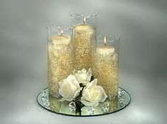 Gold ribbon wrapped dollar store vases create a beautiful inexpensive centerpiece option