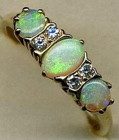 Opals and Diamonds RING... ~ Nice vintage look.  Opal is my birthstone and Diamond is my Momma's.  Love this!  :)