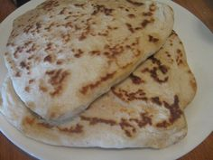 stovetop naan bread recipe... made it with freshly ground soft white whole wheat berries.  Came out great but I needed to add more yogurt, the dough was dry.