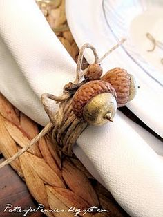 Rustic & Elegant Napkins Rings for Thanksgiving - Wrap twine and hot glue acorns - make sure it is not tied too tight that guests can't remove it! The perfect compliment to our Elegant Glitter Leaf Table Scatter mixed with acorns.  #Thanksgiving #Decorations #Family Sherman Financial Group