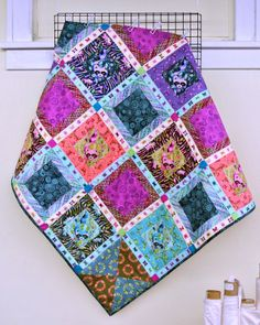 Tula Pink quilt with adorable, slightly creepy raccoons. Made by Anne at Treadle Yard Goods.
