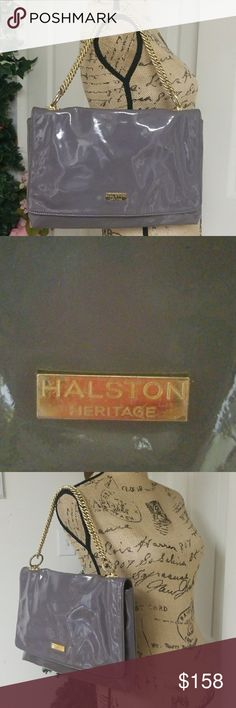 Halston Heritage Bag Perfect bag for a night out   In excellent condition inside and out   Length is 13.5 inches   Height is 9 inches   Gray with gold hardware and chains  100% Cow Leather   Lining is 100%cotton Halston Heritage Bags