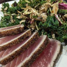 Seared Yellowfin tuna crusted with coriander and black pepper rubbed with olive oil and finished with lime. Served with a kale salad with homemade raspberry balsamic vinaigrette. 419 cal. #food #foodie #foodporn #foodstagram #eattweet #eatclean #yum #health #healthy #weekend #saturday #dinner #tuna #tataki #seared #fish #seafood #yellowfin #salad #kale #balsamic #raspberry #cloverdale #vancouver #vancity #vancityeats #yvreats #yvr by kenchernoff