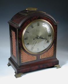 """Full Details for Lot 829 - Cheffins Webster, London, a George III mahogany bracket clock, the single pad arched top with handle, above silvered dial inscribed 'Webster. London"""", the twin fusee 5 pillar movement marked 'Rd. Webster, Exchange Alley, London', brass fret panels, all on brass bracket feet h:40 cm"""