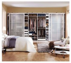 an image of an Ikea PAX wardrobe system with sliding doors the go across a full wall to provide a large amount of organized clothing storage Ikea Closet System, Closet Ikea, Pax Closet, Ikea Pax Wardrobe, Closet Space, Master Bedroom Closet, Bedroom Wardrobe, Dressing Ikea, Ikea Bedroom Furniture
