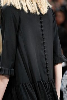 Black button-back dress with pleated cuffs; chic fashion details // Vera Wang Spring 2015