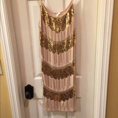 Christina Love NWT slip dress size M and L NWT cotton shift dress has adjustable bra straps and flapper style beading detail in front only Size M and L available tag attached no flaws Christina Love Dresses Midi