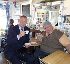 Tv show Doc Martin's Doc and Bert (Martin and Ian) on a break at the local tea shoppe in Port Issac. Doc Martins, Doc Martin Tv Show, Bbc Tv Shows, Martin Clunes, Port Isaac, British Comedy, Mystery Series, Classic Tv, New Movies